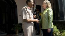 "Egyptian Field Marshal Mohamed Hussein Tantawi greets U.S. Secretary of State Hillary Rodham Clinton before a meeting at the Ministry of Defense in Cairo. Tantawi and Clinton discussed ""the political transition"" and the military's ""ongoing dialogue with President Morsi,"" a senior State Department official said. (BRENDAN SMIALOWSKI/Pool via NYT)"