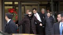 U.S. Secretary of State Hillary Clinton leaves New York Presbyterian Hospital with husband, Bill (top R), and daughter, Chelsea (R), in New York, January 2, 2013. (Joshua Lott/Reuters)