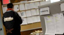 A man looks at job listings in this file photo. A new CIBC report says older Canadians are increasingly pushing students out of low-paying, part-time jobs because they can't find other work. (Deborah Baic/Deborah Baic/The Globe and Mail)