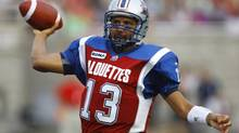 Montreal Alouettes quarterback Anthony Calvillo (13) looks to pass the ball against the Winnipeg Blue Bombers during the first half of their CFL football game in Montreal July 6, 2012. (OLIVIER JEAN/REUTERS)