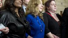 Terri-Jean Bedford, Valerie Scott and Amy Lebovitch, the three principals in the prostitution case, stand together at the Supreme Court of Canada on Friday. (Adrian Wyld/THE CANADIAN PRESS)