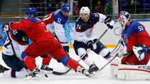 U.S. forwards David Backes, 42, and Ryan Callahan, 24, tussle in front of the the Czech Republic net as Czech Republic defenceman Radko Gudas (3), Czech Republic defenceman Michal Rozsival (32) and Czech Republic goaltender Alexander Salak defend during the second period of men's quarterfinal hockey game in Shayba Arena at the 2014 Winter Olympics, Wednesday, Feb. 19, 2014, in Sochi, Russia. (Petr David Josek/AP)