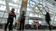 Airport police keep patrol at an arrival terminal at Heathrow Airport Wednesday, July 18, 2012 as London prepares for the 2012 Summer Olympics. (Charlie Riedel/AP)