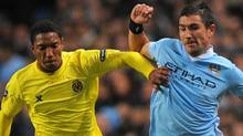 Manchester City's Serbian defender Aleksandar Kolarov (R) vies with Villarreal's Dutch midfielder Jonathan de Guzmán during their UEFA Champions league football match between Manchester City and Villarreal at the Etihad stadium in Manchester, north-west England, on October 18, 2011. Getty Images/ ANDREW YATES (ANDREW YATES)
