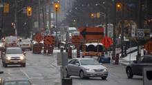 (Matthew Sherwood/TORONTO, ONT.: FEBRUARY 29, 2012 -- Traffic begins to snarl on Oriole Parkway near Kilbarry Road as a $57 million project to replace a 100-year-old watermain is underway. Both north and southbound directions are reduced to one lane for short distances.(Matthew Sherwood for The Globe and Mail))