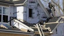 In this 2013 file photo, a builder works on the the roof of a new home under construction in Wilmette, Ill. (Nam Y. Huh/AP)