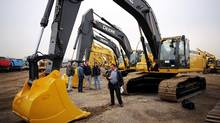 Buyers and auction staff at a Ritchie Bros.' site in Bolton, Ont. (Kevin Van Paassen/Kevin Van Paassen/THE GLOBE AND)
