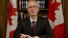 Liberal leader Stéphane Dion reads his speech in reaction to the prime ministers televised speech to the nation from his office on Parliament Hill in Ottawa Wednesday Dec. 3, 2008. (Adrian Wyld/The Canadian Press)