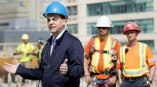 Ontario Progressive Conservative Leader Tim Hudak speaks to the media at a condominium development during an election campaign stop in Toronto on Monday, June 2, 2014. (Nathan Denette/THE CANADIAN PRESS)