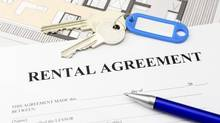A rental agreement document with keys and a pen. (Ralf Kleemann/iStockphoto)