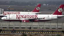 Kingfisher Airlines aircraft are parked at the airport in New Delhi in this Feb. 21, 2012 file photo. The debt-laden airline is unlikely to resume operations. (PARIVARTAN SHARMA/REUTERS)