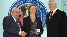 Hockey Hall of Fame inductee Geraldine Heaney is presented with her ring by Chairman Pat Quinn (right) and Chair of the selection committee Jim Gregory at the Hall in Toronto on Friday November 8, 2013. THE CANADIAN PRESS/Frank Gunn (FRANK GUNN/THE CANADIAN PRESS)