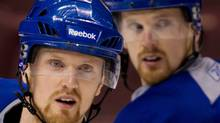 Vancouver Canucks Daniel and Henrik Sedin have responded to comments by Versus analyst Mike Milbury. THE CANADIAN PRESS/Darryl Dyck (Darryl Dyck/CP)