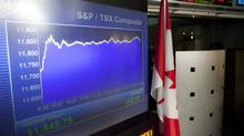 The screens at the TMX Broadcast Centre in Toronto show the closing numbers of theTSXat + 252.19 on Tuesday, July 3, 2012. (Matthew Sherwood For The Globe and Mail)