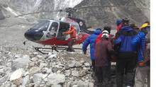 Injured Everest guides are loaded onto helicopters. (Joe Raftis)