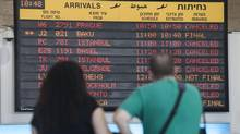 A arrivals flight board shows cancelled and delayed flights at Ben Gurion International airport. (Dan Balilty/AP)
