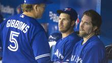 Toronto Blue Jays' starting pitcher R.A. Dickey talks with manager Gibbons in the dugout after being pulled from the game (Fred Thornhill/Reuters)