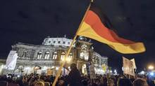 Thousands of Germans have attended rallies held by the right-wing movement Patriotic Europeans Against the Islamization of the West rallies such as this one in Dresden on in Deember, 2014. (Jens Meyer/The Associated Press)