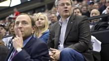 Prime Minister Stephen Harper and his daughter Rachel sit behind NHL commissioner Gary Bettman during the NHL All-Star game in Ottawa, Jan. 29, 2012. (Paul Chiasson/THE CANADIAN PRESS)