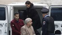 Mohammad Shafia, Tooba Mohammad Yahya and their son Hamed arrive at the Frontenac County Court House for the final phase of their trial. (STRINGER/Lars Hagberg/REUTERS)