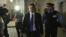 Senator Patrick Brazeau leaves the Senate chamber after it voted for him to take a leave of absence on Parliament Hill in Ottawa February 12, 2013. (CHRIS WATTIE/REUTERS)