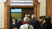 People line up at a polling station for early voting in Berlin on Sept. 20, 2013. German voters take to the polls in a general election on Sunday, Sept. 22. (THOMAS PETER/REUTERS)