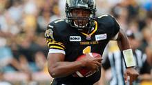 Hamilton Tiger Cats' quarterback Henry Burris carries the ball during first quarter CFL action against the Edmonton Eskimos in Hamilton, Ont., Saturday, Sept. 15, 2012. (Dave Chidley/THE CANADIAN PRESS)