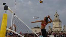 Annie Martin from Canada leaps for a spike during the Beach Volleyball match against Russia at the 2012 Summer Olympics, Tuesday, July 31, 2012, in London. (Petr David Josek/AP)