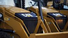 The CAT logo is seen on the front of a Caterpillar machine on a lot at Milton CAT in North Reading, Massachusetts January 23, 2013. (JESSICA RINALDI/Reuters)