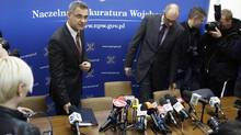 Polish military prosecutor Ireneusz Szelag, left, and press spokesman Zbigniew Rzepa arrive for a news conference in Warsaw on Tuesday, Oct. 30, 2012. Polish prosecutors denied a newspaper report that investigators found traces of explosives on the wreckage of the government jet that crashed in Russia two years ago, killing Poland's president Lech Kaczynski and 95 others. (PETER ANDREWS/REUTERS)