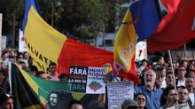 Protesters march during a rally in Bucharest, against plans to open Europe's biggest open-cast gold mine in Romania September 15, 2013. (BOGDAN CRISTEL/REUTERS)