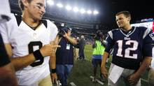 Saints QB Drew Brees, left, and his Patriots counterpart, Tom Brady, will meet Sunday for just the fifth time in their long NFL careers. (MICHAEL DWYER/AP)