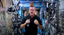 An image taken from video shows Canadian astronaut Chris Hadfield responding to a question during a news conference from the International Space Station on Thursday, Jan. 10, 2013. (Paul Chiasson/THE CANADIAN PRESS)