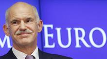 Greeck Prime Minister George Papandreou talks to media at the end of an euro zone leaders crisis summit in Brussels last week. (REUTERS/Thierry Roge/REUTERS/Thierry Roge)
