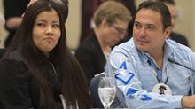 AFN National Chief Perry Bellegarde, right, sits with Rinelle Harper, 16, who survived a brutal attack in Winnipeg in November, wait for the start of the National Roundtable on Missing and Murdered Indigenous Women and Girls in Ottawa on Friday, Feb. 27, 2015. (Justin Tang/THE CANADIAN PRESS)