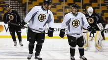 Boston Bruins' Shawn Thornton, centre left, skates with Chris Bourque, center right, during NHL hockey practice at TD Garden in Boston, Thursday, June 6, 2013. (Michael Dwyer/AP)