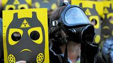 Anti-nuclear activists participate in a demonstration on March 17, 2011 in Sant Jaume square, in Barcelona. (Lluis Gene/AFP/Getty Images/Lluis Gene/AFP/Getty Images)