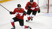 Team Canada's Jamie Benn celebrates his goal as Corey Perry lookon during the second period action of the men's semifinals February 21, 2014 at the Sochi Winter Olympics. (John Lehmann/The Globe and Mail)