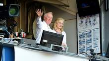 Los Angeles Dodgers announcer Vin Scully and his wife Sandra Hunt acknowedge the crowds applause for his 67 years of service after a 4-3 win over the Colorado Rockies at Dodger Stadium on September 25, 2016 in Los Angeles, California. This was Scully's final home game as he will retire at the end of the season. (Harry How/Getty Images)
