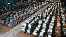 Rolls of steel are stacked inside the China Steel Corporation factory, in Kaohsiung, southern Taiwan Aug. 26. (© Tyrone Siu / Reuters/REUTERS)