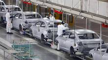In this July 10, 2012 file photo, Chinese workers assemble cars at a plant of Dongfeng Honda, a joint venture between China's Dongfeng Motor and Japan's Honda Motor in Wuhan in central China's Hubei province. (AP)