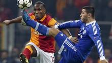 Galatasaray's Didier Drogba, left, is challenged by and Schalke 04's Sead Kolasinac during their Champions League soccer match at Turk Telekom Arena in Istanbul February 20, 2013. (MURAD SEZER/REUTERS)