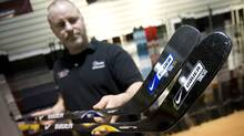 Dave Beaton, of Just Hockey Source for Sports in Toronto, holds two of the Bauer hockey sticks that have been recalled. (Kevin Van Paassen/Kevin Van Paassen/The Globe and Mail)