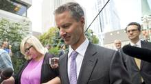 Nigel Wright, former chief of staff to Prime Minister Stephen Harper, arrives at the Ottawa courthouse in Ottawa Wednesday, Aug. 19, 2015 to testify at the Mike Duffy trial. (Justin Tang/THE CANADIAN PRESS)