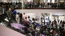 Shoppers throng Brea Mall during Black Friday shopping on Friday, Nov. 29, 2013, in Brea, Calif. The U.S. holiday shopping season started even earlier this year, as more than a dozen major retailers opened on the Thanksgiving holiday. (Jae C. Hong/AP Photo)