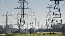 Hydro towers are seen over a golf course in Toronto on Wednesday, November 4, 2015. (Darren Calabrese/THE CANADIAN PRESS)
