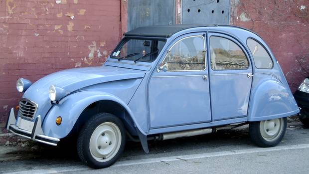 Citroen 2CV: designed to carry two peasant farmers and 100 kilos of farm goods to market at 60 kilometres per hour along roads ripped apart by artillery shells, the 2CV was super slow, and super soulful. Only the French could make this car. (iStockPhoto)
