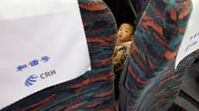 A child travels on a high-speed train in China. (China Photos/Getty Images)
