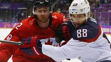 The defending Stanley Cup champion Chicago Blackhawks had 10 players in the Olympics, six of whom competed right to the end (Canadians Jonathan Toews, Patrick Sharp and Duncan Keith (left), plus Swedes Niklas Hjalmarsson, Marcus Kruger and Johnny Oduya). Moreover, a seventh, Patrick Kane (right), was playing last Saturday in the bronze-medal game for the United States (MARK BLINCH/REUTERS)
