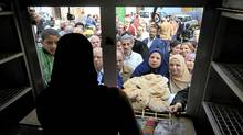 Egyptians crowed to buy bread before the start of the evening curfew in Cairo, Egypt, Monday, Jan. 31, 2011. (Amr Nabil/The Associated Press/Amr Nabil/The Associated Press)